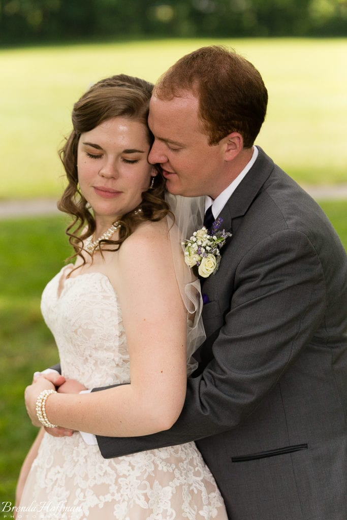 Grand Rapids Wedding Photographer bride and groom in close embrace