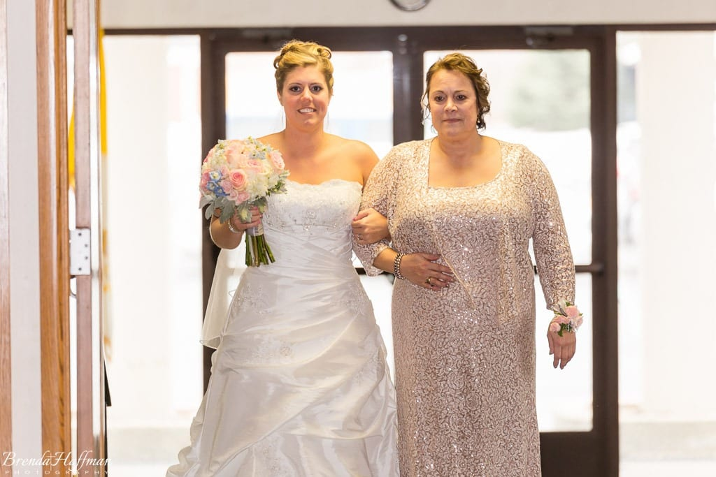 Grand Rapids Wedding Photographer St John Vianney bride enters with mother
