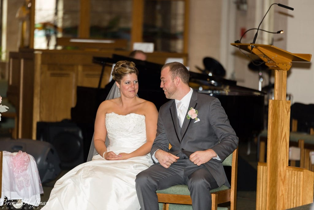 Grand Rapids Wedding Photographer St John Vianney bride and groom smile at each other