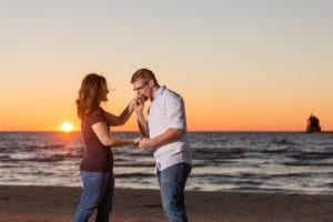 Grand Haven beach sunset engagement lake michigan pier 17