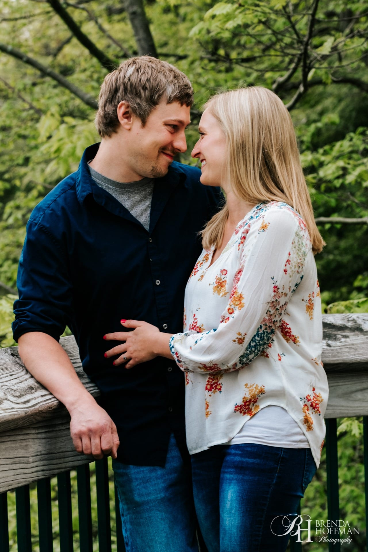 Couple by raining during engagement photos