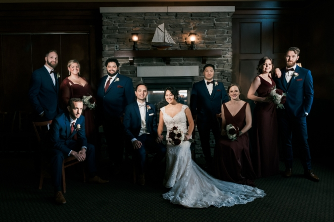 Dramatically lit wedding party photo